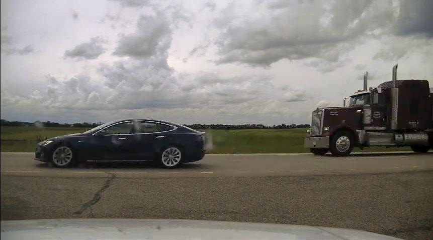 B.C. driver charged for sleeping in moving Tesla near Ponoka