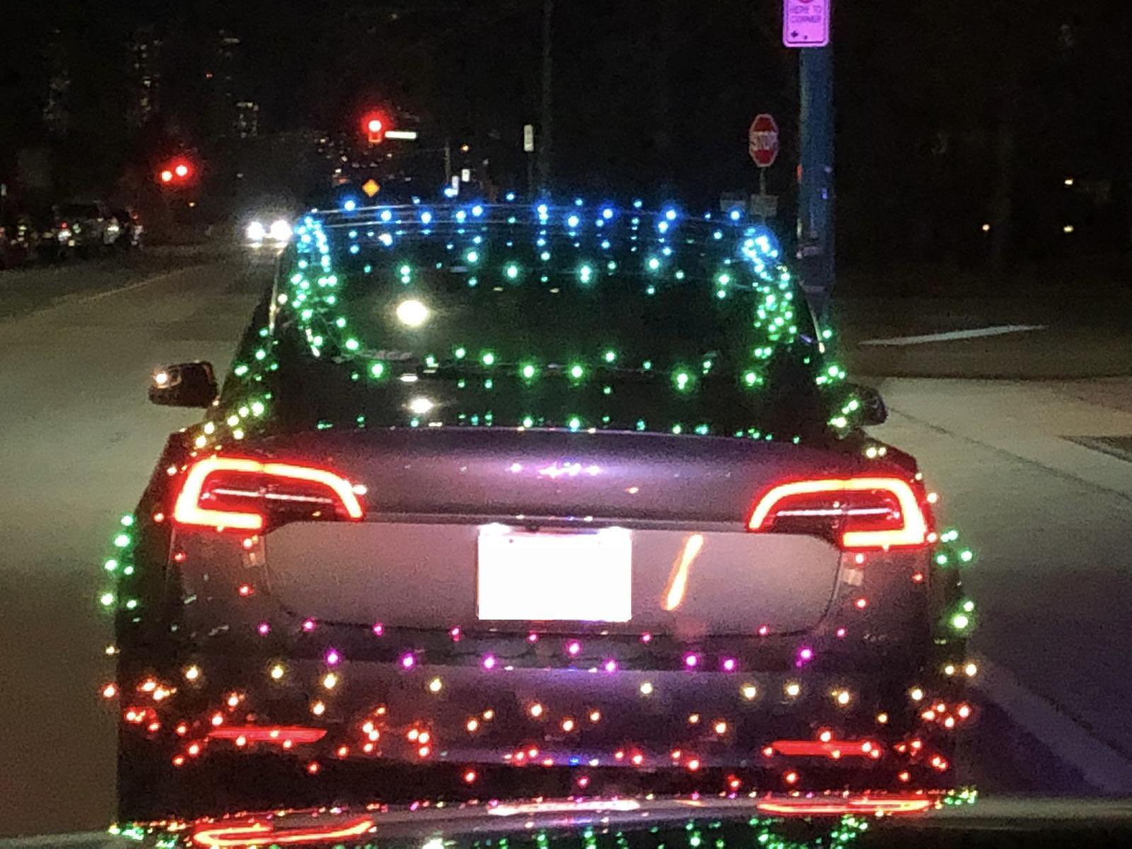 Driver in Burnaby ticketed after duct-taping Christmas Lights to Tesla - NEWS 1130